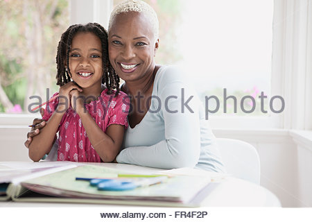 portrait of grandmother with young granddaughter - Stock Photo