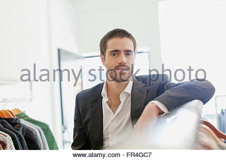 Portrait of bearded clerk in mens store. - Stock Photo