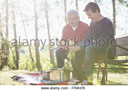 Grandfather having heart to heart conversation with grandson. - Stock Photo