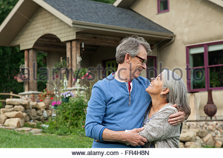 senior couple gazing into each others eyes - Stock Photo