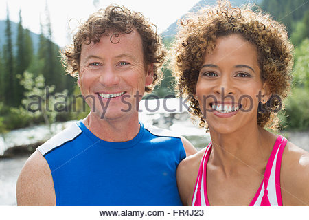 portrait of attractive, athletic couple in the woods - Stock Photo