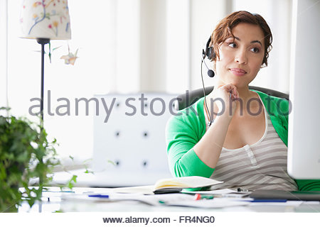 pretty, young adult on hands-free phone - Stock Photo