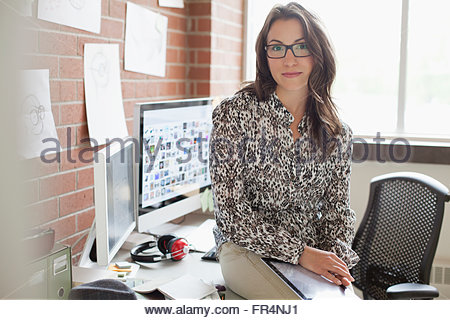 pretty, female industrial designer working in office - Stock Photo