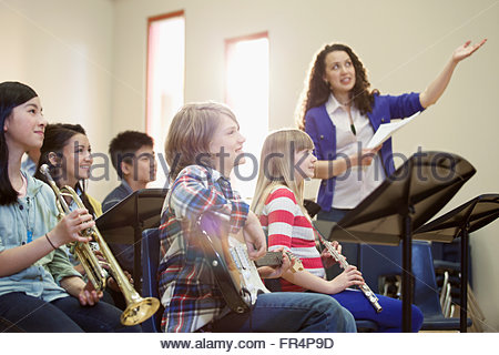 middle school students getting direction from teacher - Stock Photo
