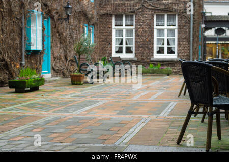 Cozy retro style urban courtyard, defocused background - Stock Photo