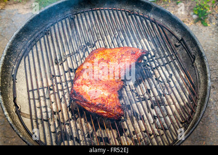 A Juicy Barbecued Tri Tip roast that has been Marinated in a seasoned soy and teriyaki sauce blend for several days - Stock Photo