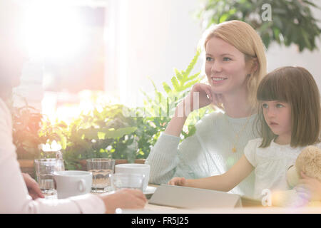Family at cafe table - Stock Photo