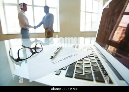 Business people shaking hands on signing a contract - Stock Photo