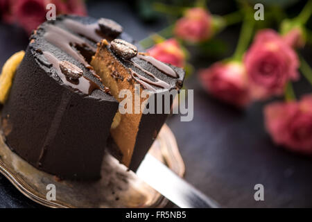 Coffee mousse and a bouquet of roses on a blue table horizontal - Stock Photo
