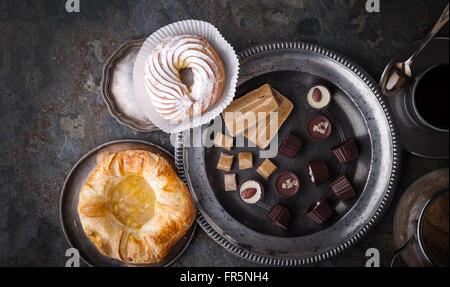 Candy, cake and coffee on a gray stone horizontal - Stock Photo