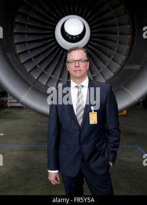 Hamburg, Germany. 21st Mar, 2016. Johannes Bussmann, CEO of Lufthansa Technik AG (LHT), stands in front of the engine - Stock Photo