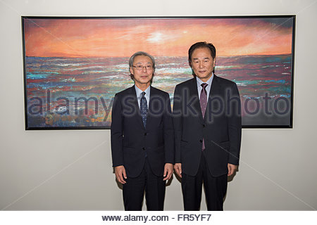 Doha, Qatar. 21st Mar, 2016. Cai Mingzhao (R), president of Xinhua News Agency, meets with Masaki Fukuyama, president - Stock Photo