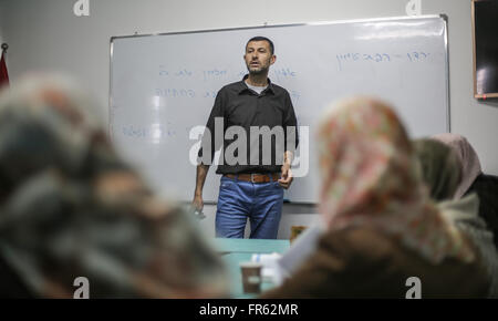 Gaza. 21st Mar, 2016. Palestinian former prisoner Ahmed Alfaleet gives a Hebrew lesson to Palestinian students inside - Stock Photo