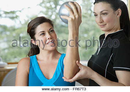 personal therapist guiding mid-adult woman - Stock Photo