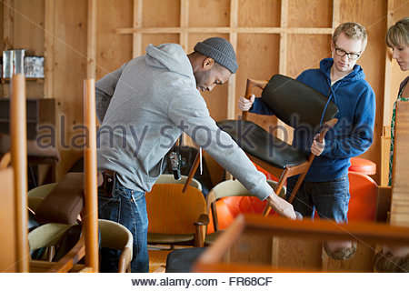 friends hanging out in workshop - Stock Photo