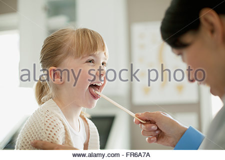 doctor examining young child - Stock Photo