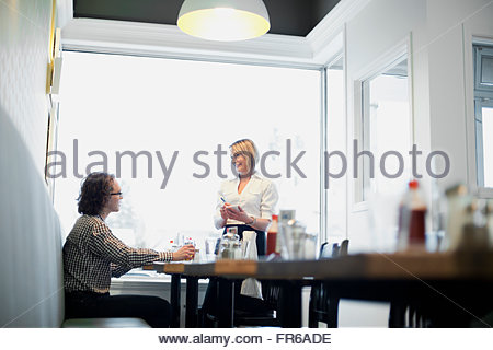 waitress taking order in diner - Stock Photo