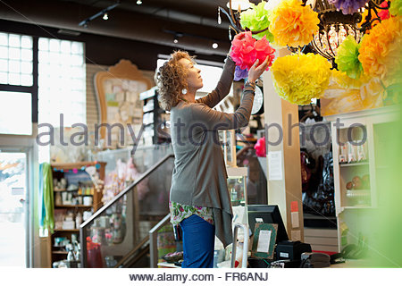 owner of stationery store doing some propping - Stock Photo