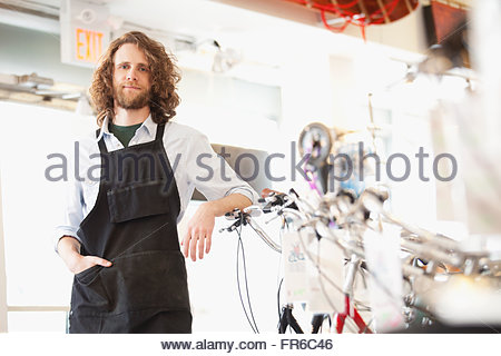 proud bike shop owner - Stock Photo