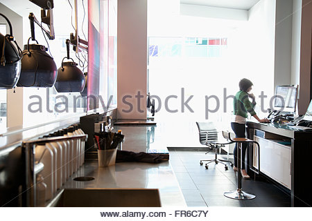 hairstylsts working at hair salon - Stock Photo