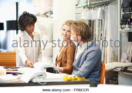 couple in discussion with designer - Stock Photo