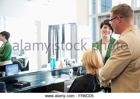 hairstylsts working at hair salon - Stock Photo