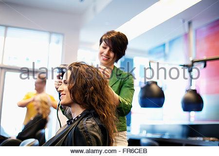hairstylists working in salon - Stock Photo