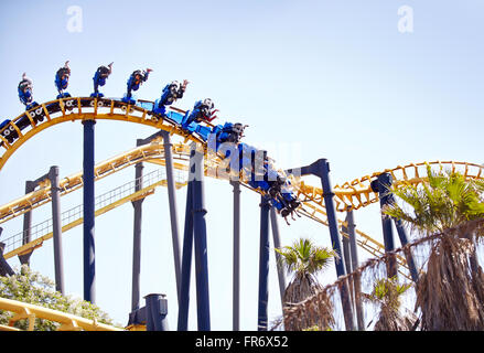 People flipping upside-down on amusement park ride - Stock Photo