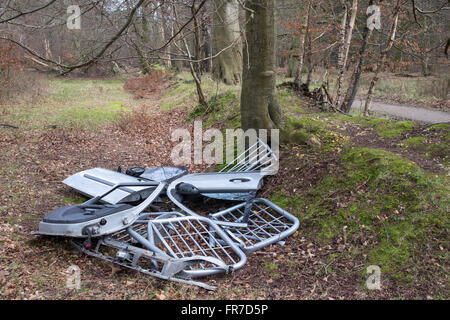 Fly Tipping Rubbish dumped in Ashridge Forest, Hertfordshire - Stock Photo