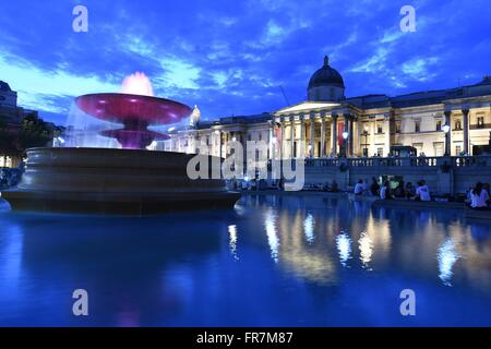 Trafalgar square, National Gallery, night, water, fountains, Tourist, London, UK, - Stock Photo