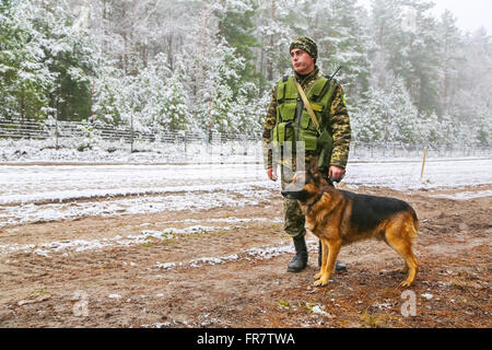 Border dog with a soldier - Stock Photo