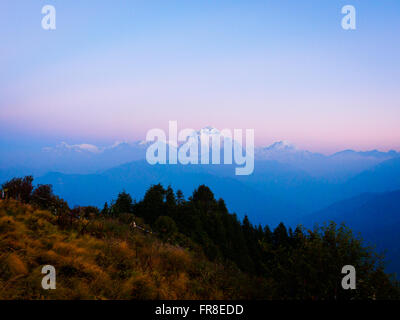 Pink dawn view to the Dhaulagiri from Poon Hill viewpoint above Ghorepani in the Annapurna Himalayas, Nepal - Stock Photo
