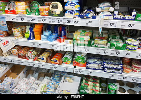 Assortment of wrapped European soft Cheeses in a store cooler of a Real Hypermarket. - Stock Photo