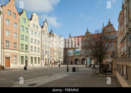 Sunny afternoon on Long Market (Dlugi Targ) in Gdansk, Poland. Green Gate in the distance. - Stock Photo