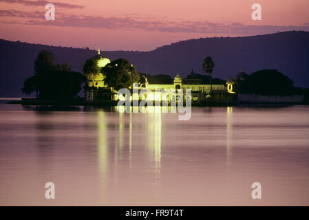 Jagmandir Palace At Night, Lake Pichola, Udaipur, Rajasthan, India - Stock Photo