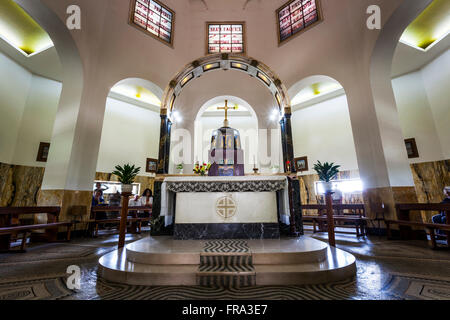 Interior of a church with stained glass windows and altar; Galilee, Israel - Stock Photo