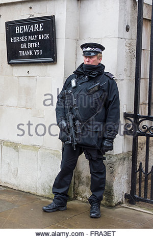 An armed policeman standing guard outside Horseguards Parade in Whitehall, London. - Stock Photo