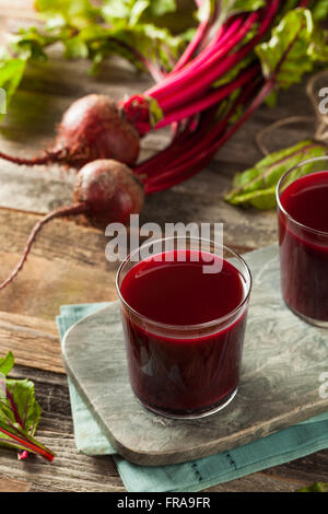 Raw Organic Beet Juice in a Glass - Stock Photo