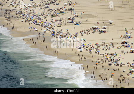 View bathers on Copacabana Beach from the top of Morro do Leme - Stock Photo