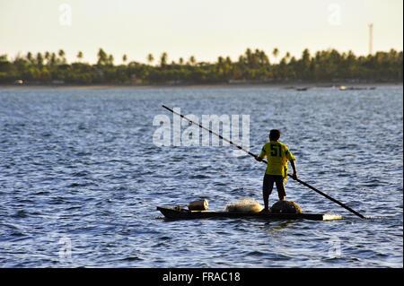 Barco de pescador na Praia de Japaratinga - Stock Photo