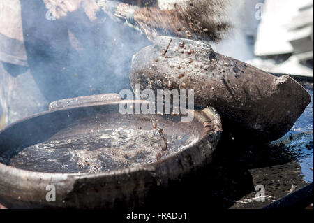 Painting pots with tannin extracted from the red mangrove - clay pots Production - Stock Photo
