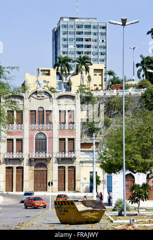 Contrast between colonial architecture of historic neighborhood of Port-General and to the modern building background - Stock Photo
