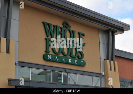 Signage with the WHOLE FOODS Market logo is displayed outside Whole Foods Store at Square One in Mississauga, Ont., - Stock Photo