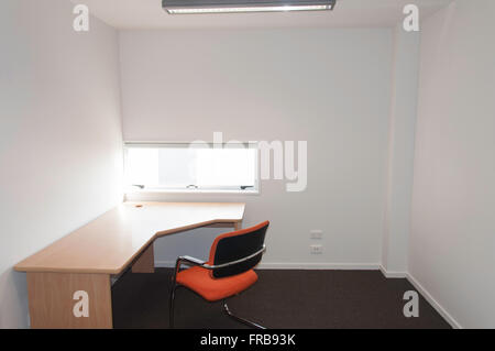 Small vacant business office with desk and chair Christchurch