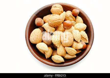 Wooden Bowl Filled with Whole Mixed Nuts - Stock Photo