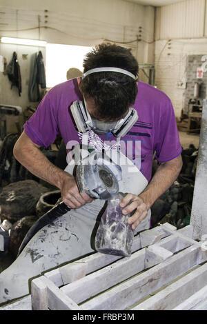 Worker polishing semi-precious stone - Stock Photo
