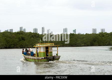 Boat on the River Capibaribe near mangroves Island of God - Stock Photo