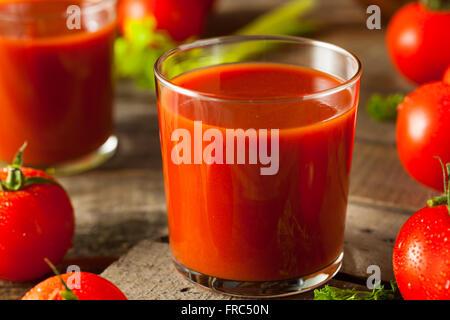Raw Organic Tomato Juice with Parsley and Celery - Stock Photo
