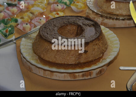 Condensed milk pudding and other sweets served on New Year`s Eve supper - Stock Photo