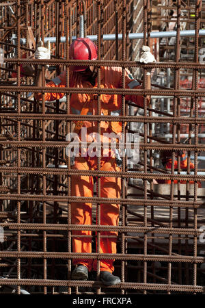 Laborer in the midst of the hardware construction of UBV 2 - pumping unit - lot 9 - Stock Photo
